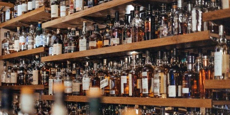 Bottles of bourbon on a bar shelf